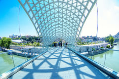 TBILISI, GEORGIA -  26, July 2017: The Bridge of Peace is pedest Stock Photography