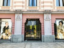 TBILISI, GEORGIA - July 10, 2018: Burberry brand shop. View of the old city hall building`s facade and old in Tbilisi, Goergia stock image