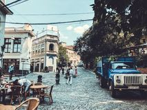 TBILISI, GEORGIA - July 10, 2018: Old town street, cafe in Shardeni street. Front of the old cargo car stock image