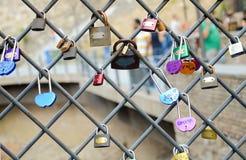 Tbilisi, Georgia. Love locks on ancient brick bridge in abanotubani. Stock Photos