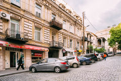 Tbilisi Georgia. Narrow Paved Street Sloped Up, Row Of Parked Cars Along The Pavement In Summer Day Stock Photo