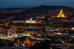 Tbilisi, Georgia at night. With Holy Trinity Cathedral of Tbilisi Sameba dominating the skyline royalty free stock photo