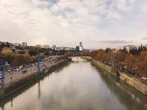 TBILISI, GEORGIA - NOVEMBER 24, 2017: Aerial view of the river Kura Mtkvari in Tbilisi, Georgia. TBILISI, GEORGIA - NOVEMBER 24, 2017: Aerial view of the river stock image