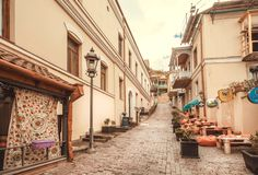 Old street of georgian capital with traditional houses and small restaurants stock photos