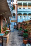 Exterior of an old house with wood balcony in the old town of Tbilisi, Georgia. Tbilisi, Georgia - 8 October 2016: Exterior of an old house with wood balcony in Stock Photography