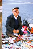 Tbilisi, Georgia - 08 October, 2016: An unidentified seller on Dry Bridge Flea market in Tbilisi sells Soviet badges and icons, re