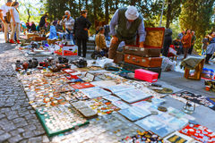 Tbilisi, Georgia - 08 October, 2016: An unidentified seller on Dry Bridge Flea market in Tbilisi sells Soviet badges and Royalty Free Stock Photography