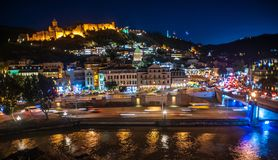 Tbilisi Old Town at night, Georgia. Tbilisi, Georgia. The Old Town comes to life at night. The Narikala Fortress has been looking down on Tbilisi in one form or royalty free stock photography