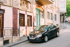 Tbilisi Georgia. Parked Black Glinting Volkswagen Jetta Car Along The Pavement Stock Photos