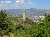 Svan tower in Open Air Museum of Ethnography and Tbilisi cityscape on the background. City view from mount Mtatsminda, Tbilisi,. Tbilisi, Georgia: Svan tower in royalty free stock images
