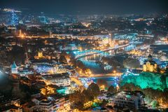Tbilisi, Georgia. Top View Of Famous Landmarks In Night Illuminations. Georgian Capital Skyline Cityscape stock images