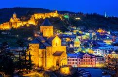 Tbilisi historical Old Town, Georgia, illuminated at night. Tbilisi historical Old Town, Georgia, with Metekhi Cathedral, Narikala fortress, Armenian Church stock photo