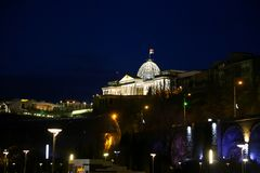 Tbilisi at night - Georgia. Night scene in Tbilisi Georgia historical centrum. Illuminated bridge of Peace and Kura river in the middle of composition Stock Photography