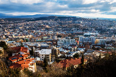 Tbilisi Sunrise. Walking down from the Mtatsminda Park on a winter morning to reach Tbilisi Royalty Free Stock Images