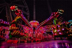 THRILL RIDES WITH COLORFUL LIGHTS Stock Images