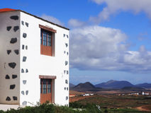 Characteristic canarian house with landscape in the background Stock Photos