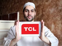 TCL Corporation logo. Logo of TCL Corporation on samsung tablet holded by arab muslim man. TCL is a Chinese multinational electronics company Stock Photos