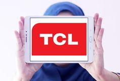 TCL Corporation logo. Logo of TCL Corporation on samsung tablet holded by arab muslim woman. TCL is a Chinese multinational electronics company Stock Images