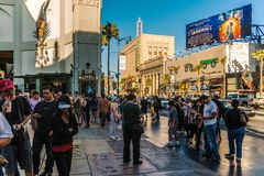 TCL Grauman`s Chinese Theatre. Tourists at the TCL Grauman`s Chinese Theatre looking at the prints of famous Hollywood celebrities, Hollywood Boulevard, Los stock images