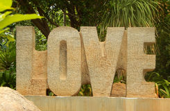 TCloseup of letters alphabets word love carved out of stone Stock Image