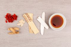 TCM immune booster. Different kind of Chinese herbal medicine for clear soup on black background. Immune booster stock photos