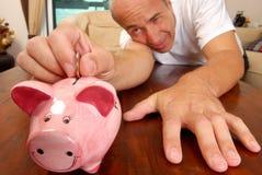 Técnica del ahorro del dinero Foto de archivo libre de regalías