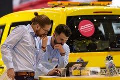 TCS的职员站立在日内瓦国际汽车展示会2018年 图库摄影
