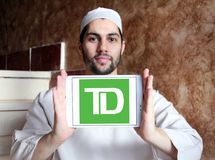TD Bank logo. Logo of TD Bank on samsung tablet holded by arab muslim man Stock Images