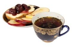 Te, äpplen och driftstopp Arkivbild