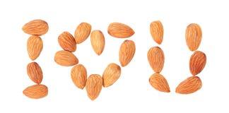 Te amo (almendras nuts en la forma del masaje) en blanco Foto de archivo libre de regalías