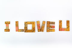 Te amo dominós de madera aislados Imagenes de archivo