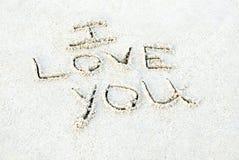 Te amo escrito en arena Fotos de archivo