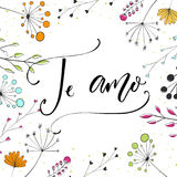 Te amo - i love you in Spanish language. Modern calligraphy for Valentine`s day card. Vector typography and wild flowers.  Stock Image