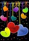 Te amo tarjetas colgantes del día de tarjetas del día de San Valentín de los corazones Imagen de archivo libre de regalías