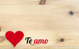 Te Amo Text and Red Heart. On a Wooden Background Royalty Free Stock Photography