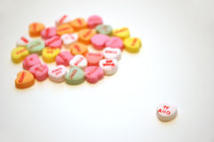 Te Amo Valentines Conversation Hearts. A group of Spanish Valentine's Day conversation hearts (corazones dulces) with a white te amo heart in the foreground. En stock photography