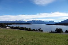 Te Anau Lake with snowtopped mountains, New Zealand stock photography