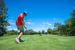 Te del golfista apagado Imagenes de archivo