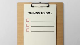 Te doen dingen geschreven op Klembord stock fotografie