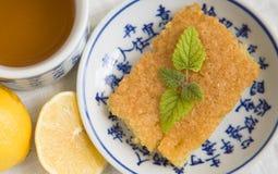 Te- och citronsockerkaka Royaltyfri Bild