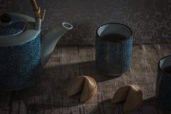 Te och förmögenhetkaka fotografering för bildbyråer