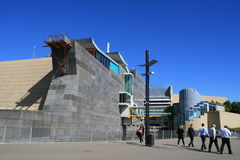 Te Papa Museum, Wellington, New Zealand. Business men walking past famous Te Papa [Our place in Maori language] museum in Wellington Stock Photo