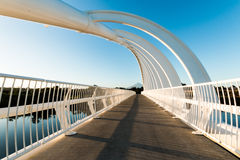 Te Rewa Rewa Bridge Walkway. Reminiscent of both a breaking wave and whale skeleton, the international award winning Te Rewa Rewa Bridge is New Plymouth's newest Royalty Free Stock Photos