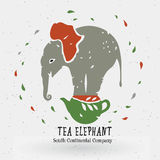 Te shoppar logoen, symbolet, elefanten på te på kokkärlet Arkivbild
