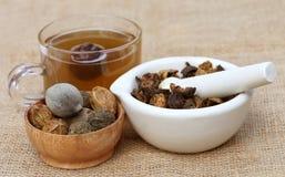 Te som göras från Triphala arkivbild