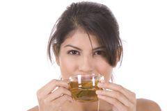 Tea. Young woman on white with a cup of tea Stock Photography