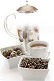 Tea. Two kinds of chineese tea separately and infused in cup and glass tea pot Stock Photography