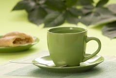 Tea. Cupful of tea with dessert Stock Photos