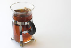 Tea. Brewing in a glass against a white background stock photography