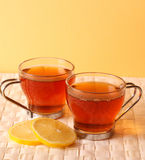 Tea. Time -  cups with lemon close-up royalty free stock image